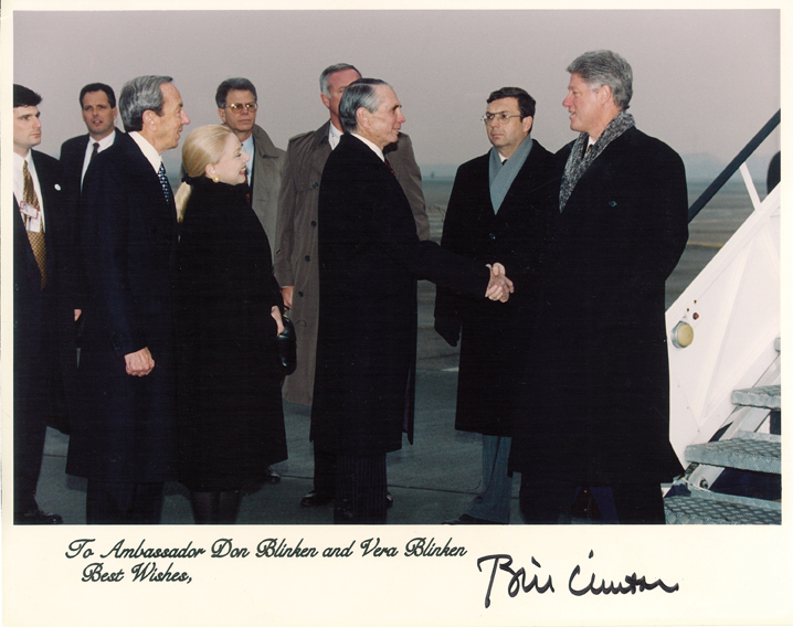 Greeting President Clinton outside Air Force One